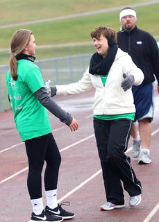 St. Charles Middle School Heart & Sole Coach Ellen McFall congratulates Kaylee Buckman with a hug after she finishes the practice 5k Saturday morning.