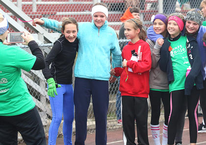 A group of Girls on the Run and Heart & Sole participants from several schools gather together for a group photo. They are, from left, Josie Followell, Anne-Michelle Hughes, Marissa Bauerle, Brianna Knopp, Kaye Piekarski and Emily Spalding. Taking the photo is St. Augustine Grade School Heart & Sole Coach Amanda Knopp.