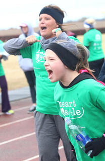 Lebanon Middle School Heart & Sole participant Laura Thomas and Lebanon Middle School Heart & Sole Coach Casey Spalding cheer on the girls as they finish the practice 5k.