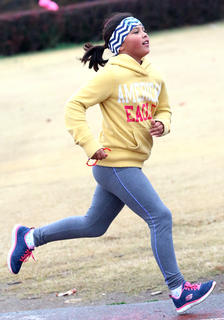 Lea O'Daniel, a fifth grade student at Lebanon Elementary School, has perfect running form as she makes her way around the track Saturday morning.