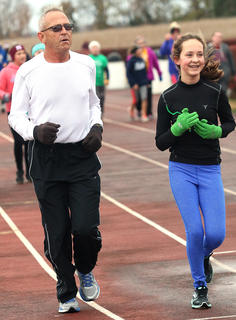 Josie Followell, right, runs with her grandfather, Otha Allen, a longtime supporter of Marion County's Girls on the Run program, during the practice 5K Saturday morning.