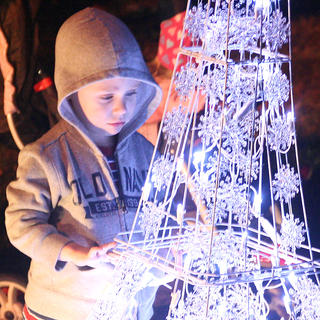 Caleb Downs is mesmerized by the holiday lights at the park.