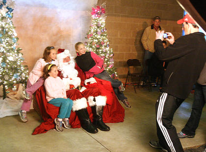 Children pose for photos with Santa Claus.