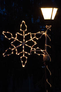 Illuminated snowflakes adorn the light posts at Graham Memorial Park.