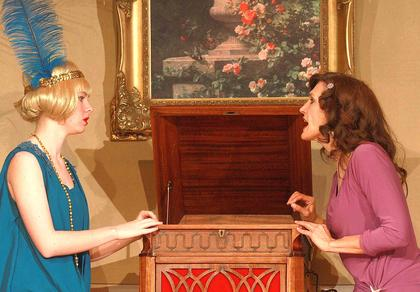 Jade Fields (left, played by Mary Sue Gray) and her sister, Violet (played by Robin Humphress) disagree about whether New York is a good place for a single woman to live.