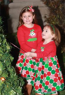 After Mia Mattingly, 6, lit the community Christmas tree, her sister, Molly, 3, tried out the magic wand. They are the daughters of Kurt and Amy Mattingly.
