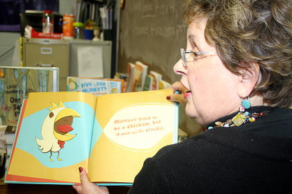 Janelle Miller with Marion County Head Start reads to students in one of the many activity rooms.