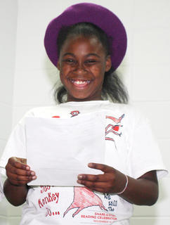 Teasia Newby giggles during a skit with students from the 21st Century Community Learning Center.