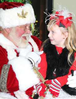 Kylie Spalding shares a special moment with Santa. She is the daughter of Chad and Kristin Spalding.