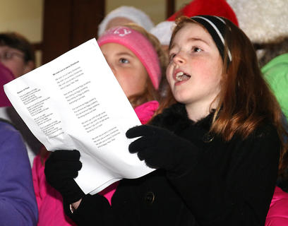 Students from local elementary schools sing Christmas carols on the steps of the Marion County Heritage Center Friday evening during the Dickens Christmas event in downtown Lebanon.