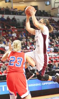 Junior Makayla Epps goes to the basket during the semifinals against Lincoln County.