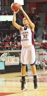 Junior Kyvin-Goodin Rogers pulls up for a shot in Thursday's state tournament game against Walton-Verona.