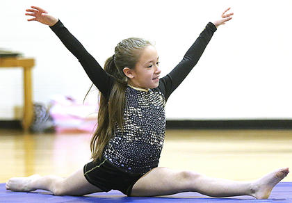 Leticia Newton performs a gymnastics routine.