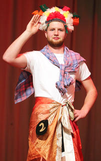Connor Higdon waves to the crowd during the poise portion of the competition.