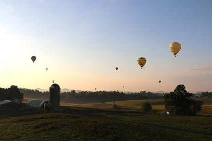 Silos and hot air balloons... It must be Marion County Country Ham Days. The balloons were back for this year's festivities. Limestone Branch Distillery in Lebanon was the sponsor of both the Yellowstone Balloon Glow and the Limestone Branch Hot Air Balloon Lift-Off.