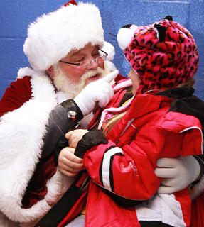 Santa reminds Susie Fife, 6, to keep being a good girl.