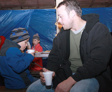 Kris Bickett and his son, Kayden, 6, enjoy some hot chocolate.