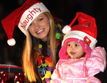 Ashley Munroe's holiday hat says she's naughty, but Harper Thomas looks like she's a good little girl.