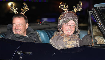 Bobby Ballard, front, and a handsome man in the backseat (who we weren't able to get identified, although we tried desperately) get into the holiday spirit with their camouflage antlers.