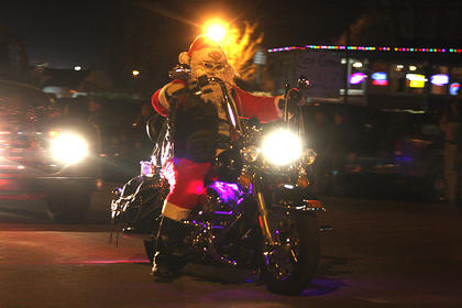 Santa Claus apparently left his sleigh at the North Pole and drove his Harley Davidson motorcycle to the parade.
