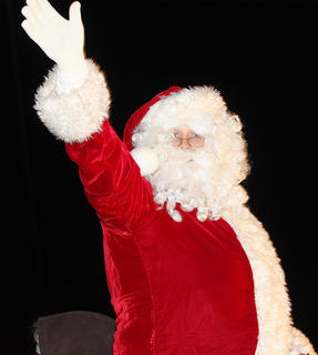 There were lots of Santa impersonators in the parade this year. This Santa Claus waves to the crowd as the parade nears its end.