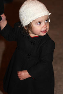 Amelia Mattingly, daughter of Daniel and Sarah Mattingly, is warm and toasty in her stylish pea coat and knit cap.