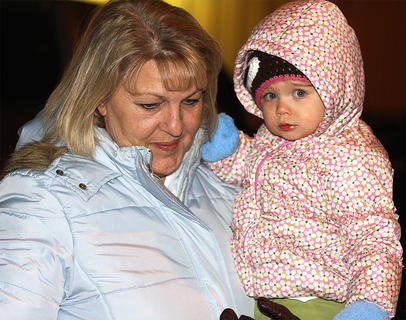 Bernadette O'Daniel holds her granddaughter, Ansley Clark, who is all bundled up and not a bit camera shy.