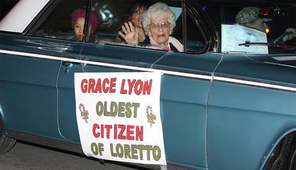 Grace Lyon is treated like royalty, rightfully so, as she rides in the parade as the oldest citizen in the City of Loretto.