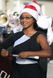 Jarie Newby helped carry the sign for the Marion County Marching Knights in the parade.