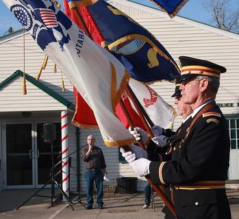 The Marion County Veterans Honor Guard carried the American flag and flags for each branch of the military near the lead of the parade.