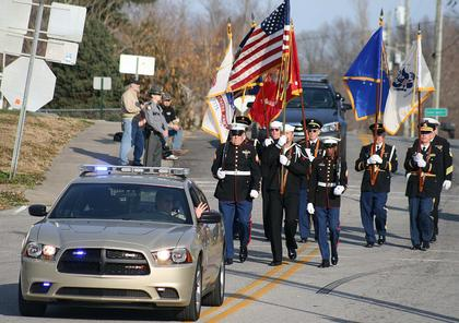 Marion County Sheriff Jimmy Clements led the parade by driving the cruiser that belonged to the late Deputy Anthony Rakes. The Marion County Veterans Honor Guard followed behind him. Anthony Rakes was named the honorary grand marshal of this year's parade.