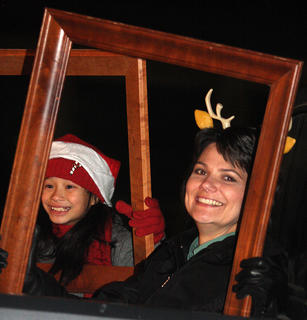Dora Lyons Bickett promotes Picture This Frame Shop during the parade.