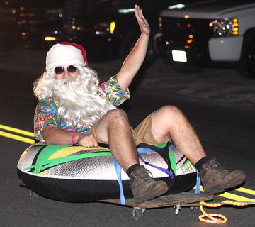 The City of Loretto was lively Friday evening during its first-ever Christmas parade. Pictured is Eric Miles, dressed as Santa, tubing down the road. His family's float, Christmas in July, included a boat, and several reindeer, including Prancer, Rudolph, Dancer and Blixen, who were all enjoying a vacation of sun tanning and fishing.