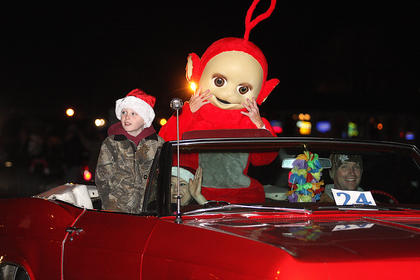 A Teletubby was a big hit in the parade. Pictured is Pat Thomas, driving, his wife, Tammy, their son, Jake and Margie Greenwell dressed as the Teletubby.
