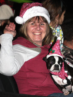 Patty Jo Corbett Byrd and her dog enjoy being in the parade.