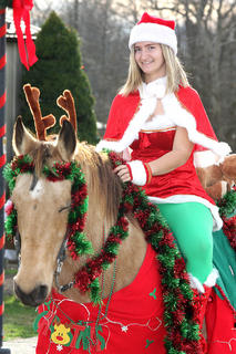 Kayla Cash and her horse, Sugar, were all decked out in Christmas attire for the parade.