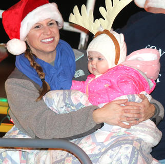 Amanda Nugent holds her daughter, Ava, tight as they try to stay warm during the Loretto Christmas Parade Friday evening. Not pictured is Amanda's husband and Ava's daddy Joe Ray Nugent.