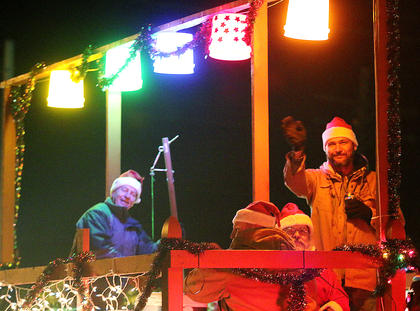 Musicians from Doug's Tavern play music on their festive float during the Loretto Christmas Parade.