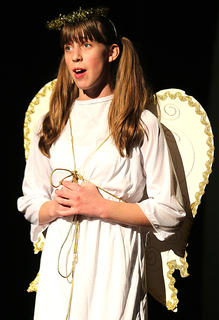 Beth Bradley, being played by Jessica Thomas, goes back in time to tell the story of The Best Christmas Pageant Ever.