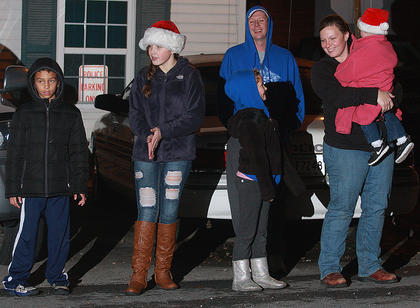 While many people sat in their vehicles to watch this year's parade, Devin Gribbins (8), Kaylee Cheatam (13), Tori Gribbins (7), Kirby Gribbins, Amber Gribbins and Presley Gribbins (23 months) watched from the street.