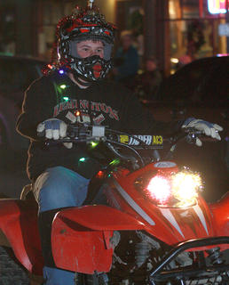 Nathan Mink rolls through the parade on his ATV.