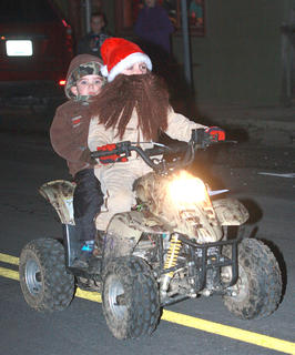 Carson and Colin Raikes took a cue from Duck Dynasty in their entry in the Bradfordsville Christmas parade.