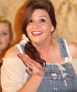 "Carrie Lee Spalding plays ""Sunshine"" during one of the Hee Haw skits."