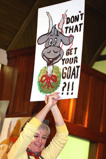 Pam Brady holds up a humorous sign to stir up the crowd.