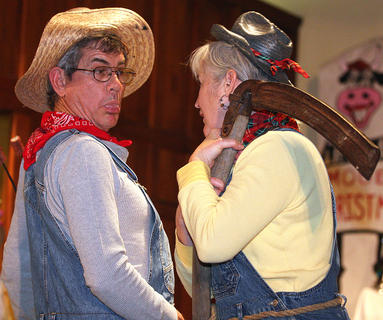 Ronnie Hill sticks his tongue out during a skit with Pam Brady.