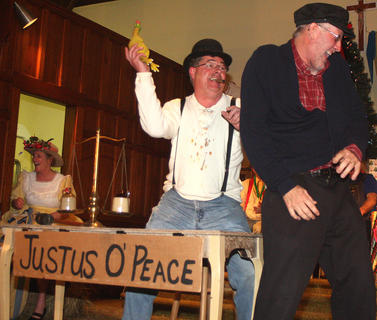 "Stephen Brady plays a judge during the ""Justus O'Peace"" skit. Brady appears to be assaulting Danny Brady with a rubber chicken."
