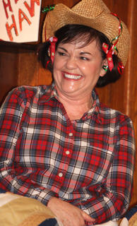Kathy Spalding laughs during her role as one of the gossip girls.