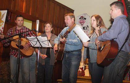 The Reynolds family performs for the crowd. They are, from left, Chris, Sue, Frankie, Gwen and Mark.