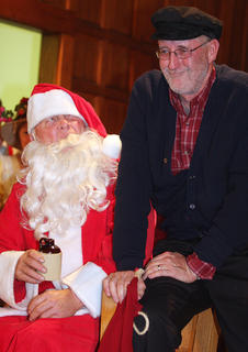 Phillip Buckman, dressed as Santa, and Danny Brady have a heart-to-heart.