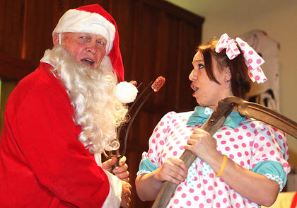 Phillip Buckman, dressed as Santa, and Jamie Bell perform a skit together.
